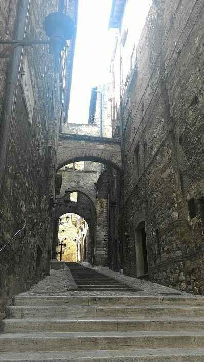 Città medievale XI sec aspetto e vita quotidiana
