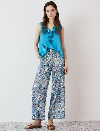 Come abbinare i pantaloni fantasia negli outfit